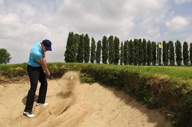 golfer playing out of a bunker